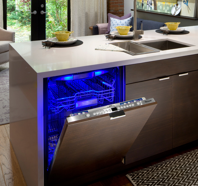 Open Thermador dishwasher with a sapphire glow