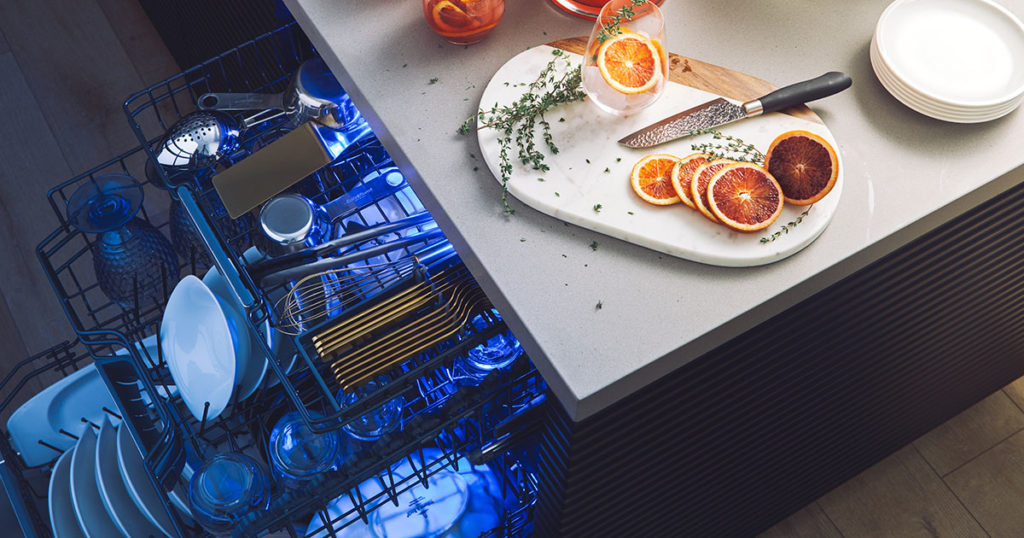 Open Thermador Star Sapphire dishwasher with blue light