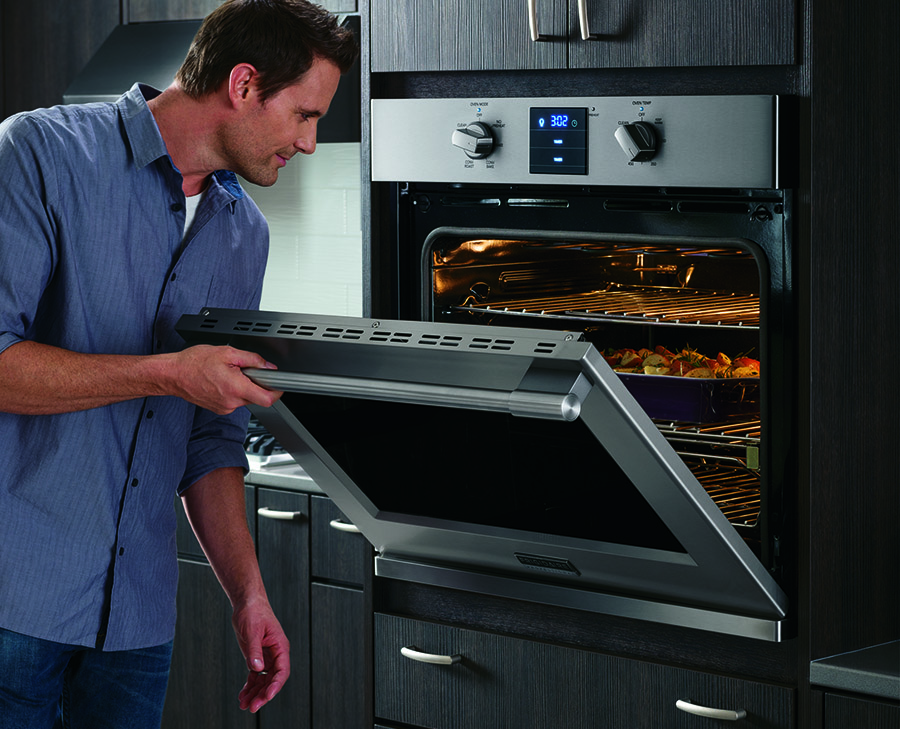 Man peaking into Frigidaire oven